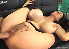 Trashy hoe with huge boobs is getting banged hard doggy style
