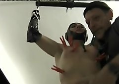 Latex Slavegirl gets a hard cunt and tit slapping