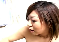Asian slut sucking on a hard cock real well