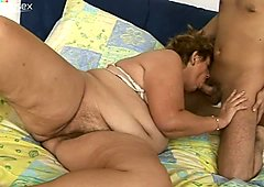 Perverted young stud is playing with wet cunt of fat kinky granny