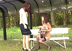 Naughty Asian milfs are enjoying lesbian sex outdoors