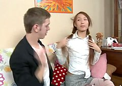 Petite Asian girl Ajenda flashes her bra in front of horny tutor
