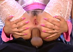 Bright curly blonde in lacy stockings gets her both holes drilled properly