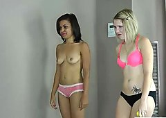 Two beautiful ladies strip while playing toss the balls