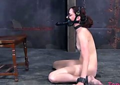 Sexy chained hooker is ordered to ride huge plastic dildo