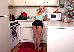 Amazing blonde young l rubs her twat in the kitchen