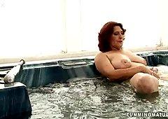 Oversized mature BBW drills her bushy cunt with baseball batt in bathtub