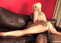 Blonde tattooed pornstar Christie Stevens swallows bbc