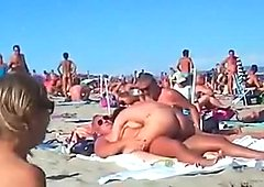 Voyeur tapes multiple couples fucking at a nudist beach