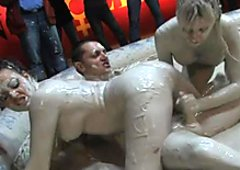 Kiny Terri Summers and her GF in dirty threesome in mud bath