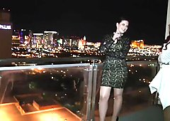 Busty chick gets tied up and teased on the balcony