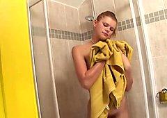 Busty slut masturbates in the shower