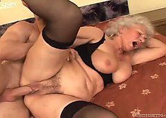 Busty granny in nylon stockings riding hard dick on top in kinky old and young fuck video