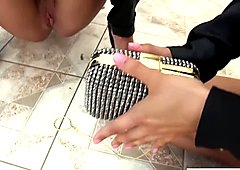 Sexy lesbians pissing into a fancy purse