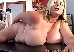 Mega breasted blonde MILF shows off her large jugs