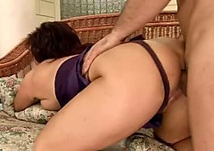 Chunky granny with saggy tits is banged hard by horny young stud