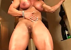 Strong body girl shows off her muscles and masturbates