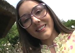 Cute nerdy brunette girlie flashes her small tits and smooth butt outdoors