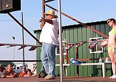 interesting amateur pole stripping contest at a iowa biker rally