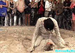 Two european beauties wrestling in mud