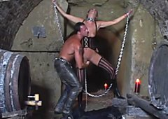 Submissive whore is chained and sexually tortured in a hot BDSM porn video