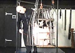 Amateur slavegirl in a cage