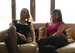 Two salacious nymphos with shapely tits take part in a threesome