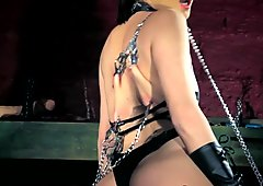 Tormented chained babe plays with toys