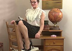 Sofia Matthews is a hot MILF teacher masturbating