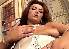 Appetizing big bottomed brunette babe in white corset masturbates twat