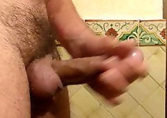 Rubbing lotion on my hard uncut cock shaved balls