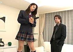 Tasty looking Japanese student Satomi Suzuki masturbates in front of horny dudes