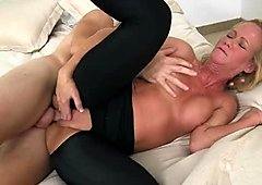 Tattooed milf in crotchless yoga pants is fucked in missionary position from behind